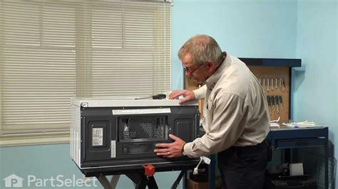 microwave repair replacing  light bulb