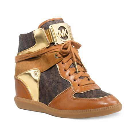 wedge sneakers macy s lyst michael kors nikko high top wedge sneakers in brown