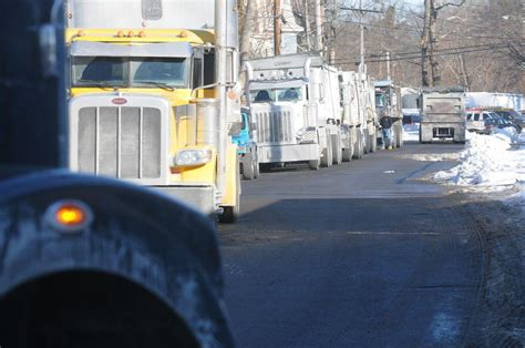 out of state trucks line up outside taunton salt depot