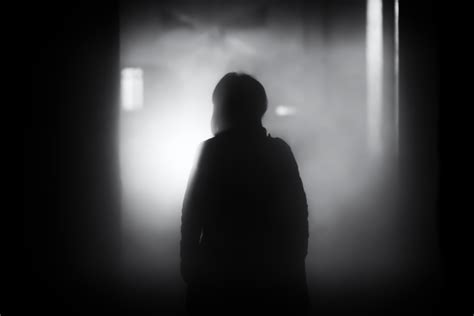 A Light In The Shadow free images silhouette person light black and white