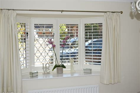 how to dress a bay window with shutters shabby chic