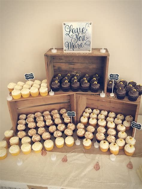 Cupcakes displayed in wooden crates for wedding   Cupcakes