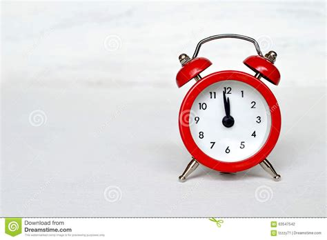 happy light alarm clock red vintage alarm clock striking midnight or midday