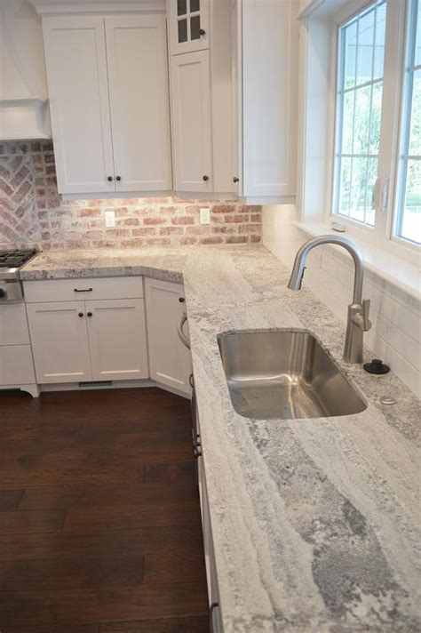 Quartzite For Countertops by Gray Quartzite Countertops With Stainless Steel Kitchen Sink Transitional Kitchen