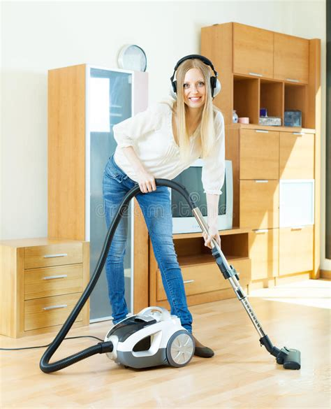 Vacuum Cleaner Happy King in headphones cleaning with vacuum cleaner stock photo image 31401282