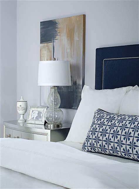 gray  navy bedroom metallic silver nightstand navy upholstered headboard purple gray