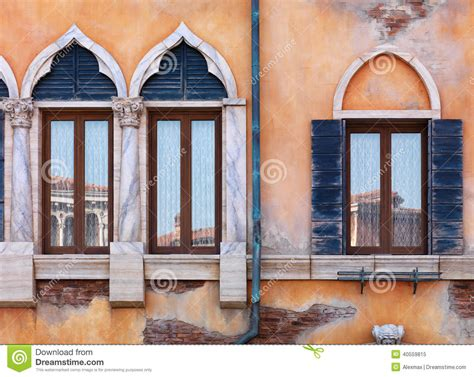 classic venetian window shapes create architecturally old arched windows of venetian house stock photo image