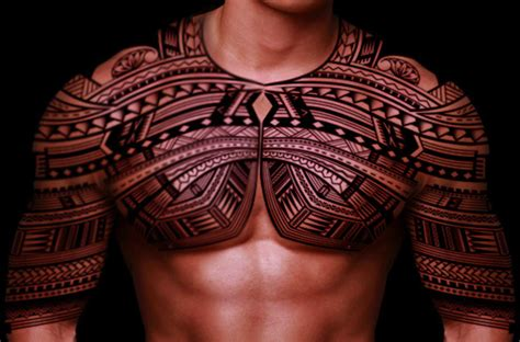 symmetrical tribal tattoos fallen in with his arms and chest symmetrical and i