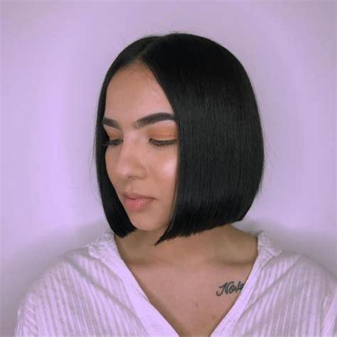 bobbed hair middle parting black coloured women s black sleek bob with slight angle medium length