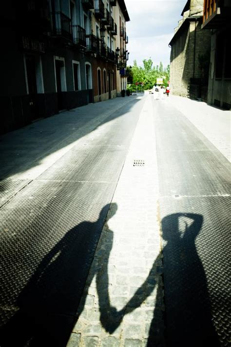 shadow   couple holding hands  stock photo