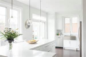 White L Shaped Kitchen With Island by Caesarstone Calacatta Nuvo Countertops Design Ideas