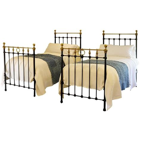 iron twin bed matching pair of twin brass and iron beds at 1stdibs