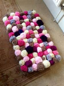 pom pom rug decoration for a more cheerful and colorful