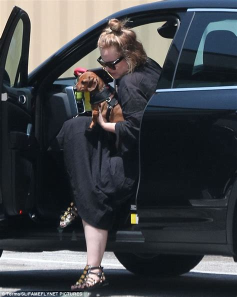 adele has never driven a car with a standard transmission before adele heads out to buy balloons with pet dog louie in