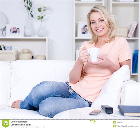 relaxing on the couch woman relaxing on the sofa stock image image 16687361