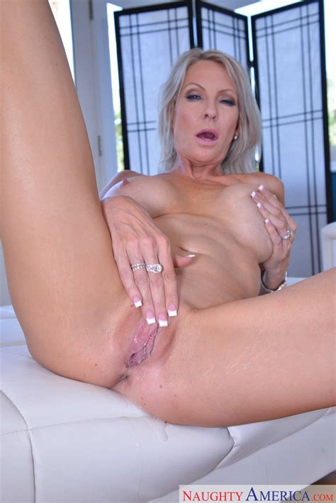 Sexy Blonde Mature Fucks Younger Dude In Her Living Room