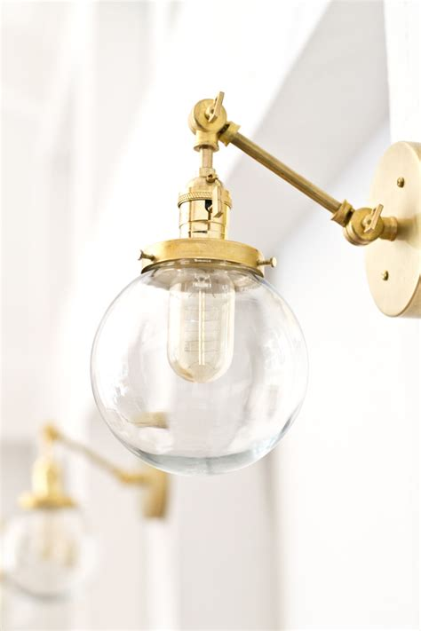 bathroom sconce lighting fixtures make this gorgeous brass globe sconce for around 70