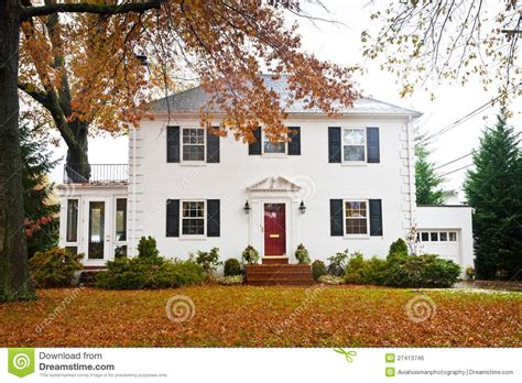 white home dream home house steps suburbs shutters front white home with a red door stock photo image of holiday