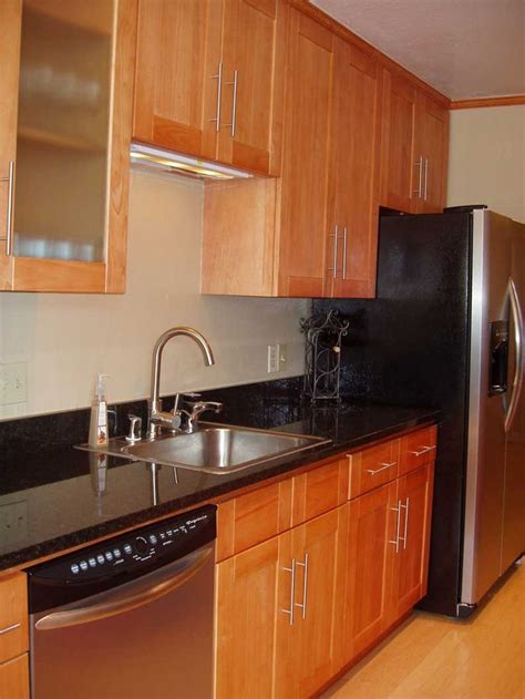 black shaker kitchen cabinets honey oak kitchen cabinets with black countertops honey
