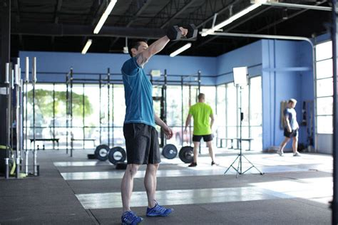 dumbbell swing bodybuilding vertical swing exercise guide and video