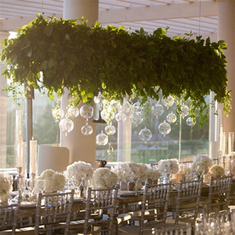 suspended greenery arrangement with candels wedding