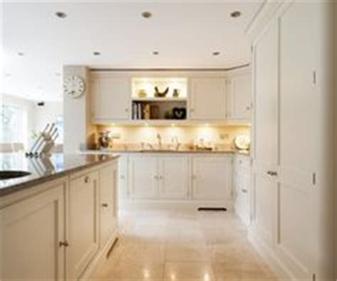 cuisiniste guing open kitchen with front door by would be to