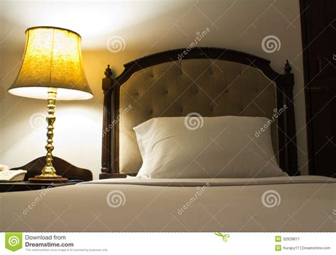 table next to bed l on a night table next to a bed royalty free stock
