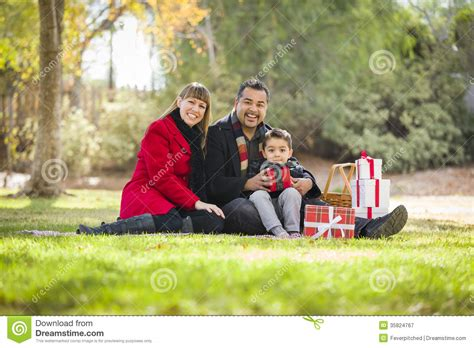 happy mixed race family opening christmas gifts stock