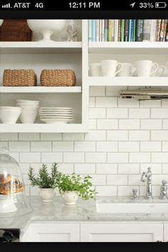 22 light grey subway white grout with decorative line dark cabinets white subway tile backsplash and revere