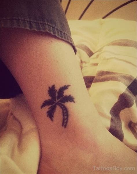 small palm tree tattoos small black palm tree on leg