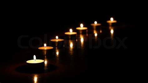 candele on line candles in the line of candles stock photo