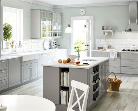 light grey kitchen walls white appliances white counters light grey cabinets http