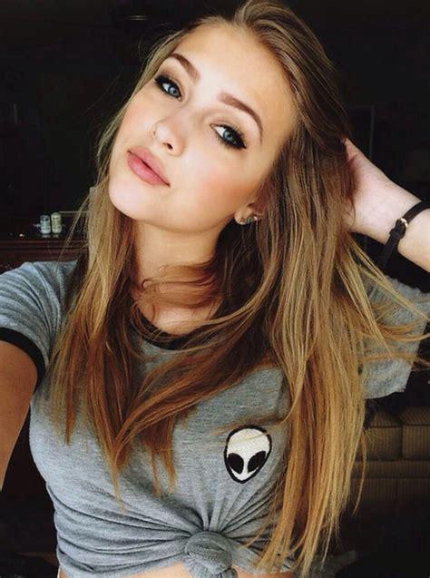 blonde hair dark eyebrows