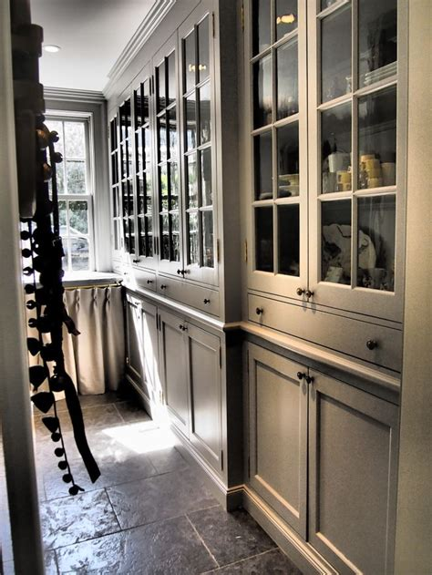 pantry cabinet with glass doors antique brass porthole inserted in swinging door fb