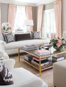 fashion home interiors living room with gray walls and pink decor accents