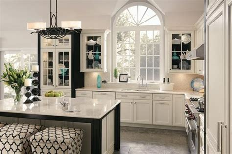 kraftmaid white kitchen cabinets kraftmaid dove white painted cabinet with cocoa glaze i