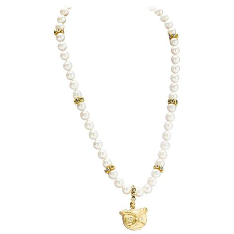 gold owl pendant pearl necklace with sapphire spacers for