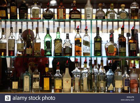 liquor bottle shelves liquor bottles on shelves at a bar stock photo royalty