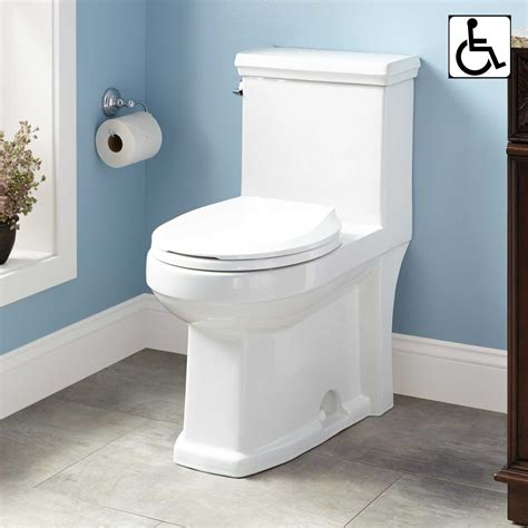 bathroom with two toilets koenig one piece round siphonic toilet ada compliant