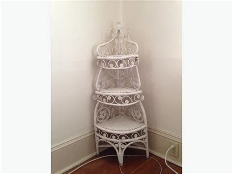 white wicker corner shelf city