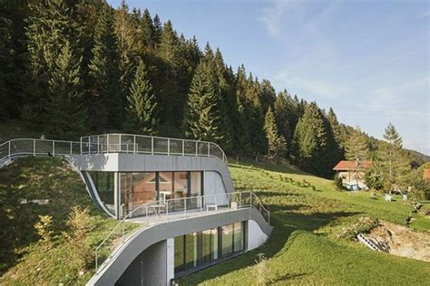 homes built into hillside swooping home is partially built into a hillside