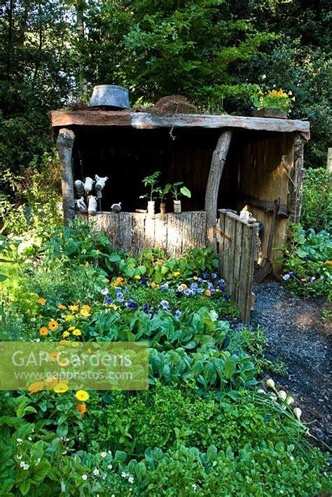 Gap Gardens Rustic Wooden Shelter In Vegetable Garden Vegetable Garden Silver