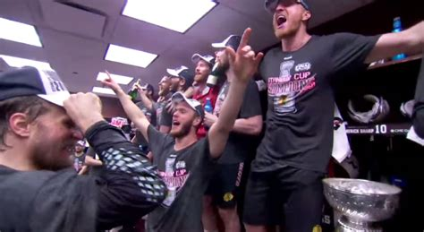 chicago blackhawks dressing room blackhawks sing quot we are the chions quot after cup win puck
