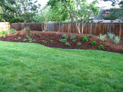 backyard berms photos google search landscape design garden flowers pinterest