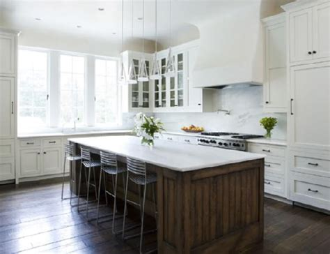 white kitchen wood island metal bar stools wooden kitchen island wooden floor white cabinets kvriver