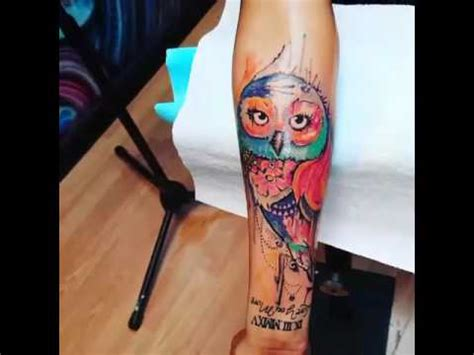 watercolor tattoo pain gets watercolor owl on forearm no