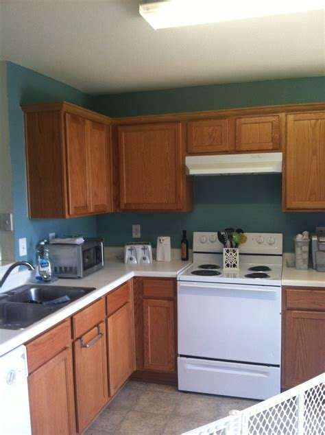 behr paint color for kitchen cabinets behr venus teal paint oak cabinets kitchen home