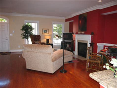 red accent wall in living room image painting sitting area fireplace red accent wall