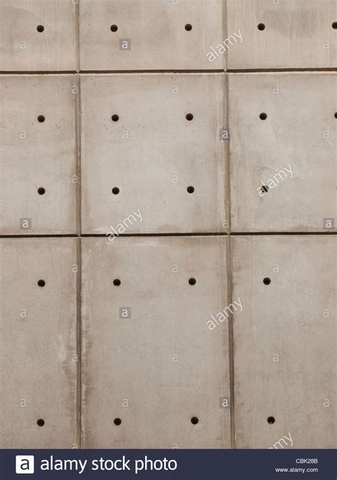 hole pattern en francais raw concrete wall background with formwork lines and tie