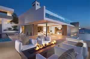 Glass Living Room - incredible beach house in california brings the ocean indoors